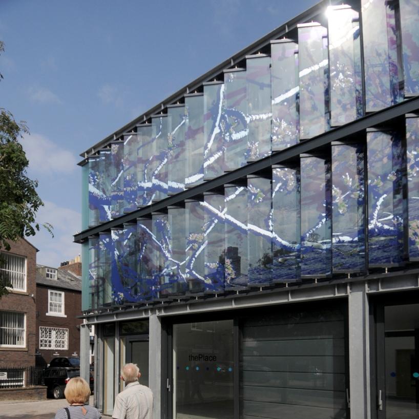 glass fins alongside contemporary building